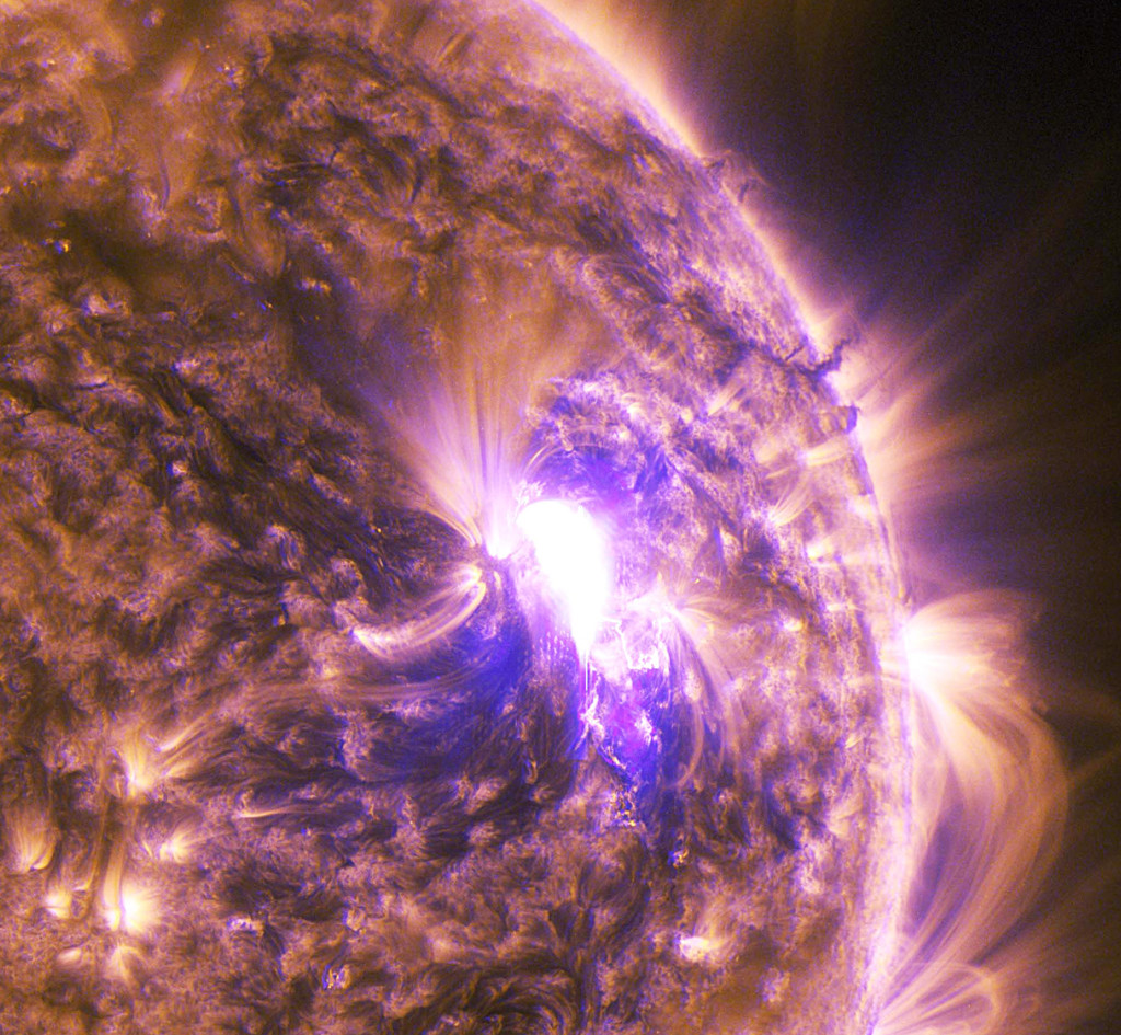 Solar flares eminating from the sun.